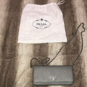 Authentic Gray Prada wallet on a chain bag